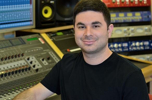 Dave Tatasciore in one of the College's recording studios. Photo by Matt Carlin
