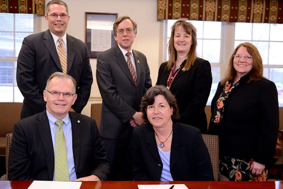 From left, seated are James T. Harris III, president; Widener; and Karen A. Stout, president, MCCC. Standing are Edwin Wright, executive director of admissions, Widener; Stephen C. Wilhite, provost and senior vice president, Widener; Victoria Bastecki-Perez, vice president of academic affairs and provost, MCCC; and Kathrine Swanson, vice president of student affairs and enrollment management, MCCC. Photo by Sandi Yanisko