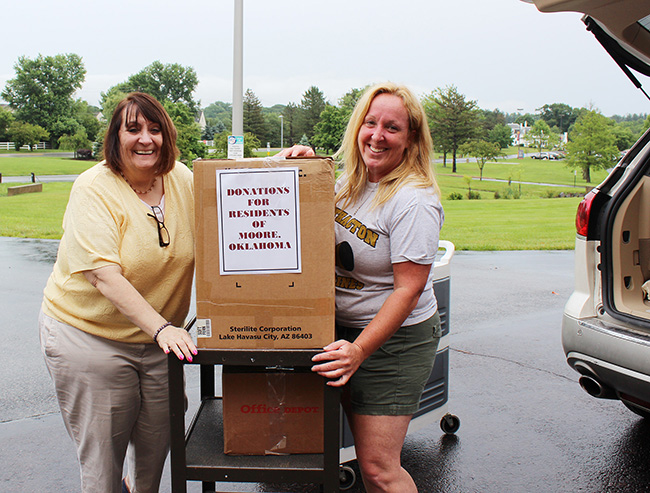 Second year Nursing student Patti Marcus and MCCC Director of Nursing Maria Toth load boxes collected by the College's students and faculty. Photo by Alana J. Mauger