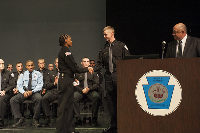 Cadet Lt. Andrew Thiel of Class 1302 transfers command to Cadet Lt. Laina Stephens, Class 1304. Photos by John Welsh