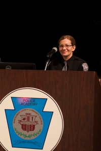 Class 1302 Valedictorian Cadet Hope A. Sanderlin addresses cadets.
