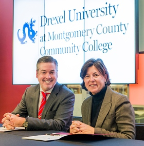 Presidents John A. Fry (Drexel) and Dr. Karen A. Stout (MCCC) signed the agreement on Jan. 8. Photo by Sandi Yanisko