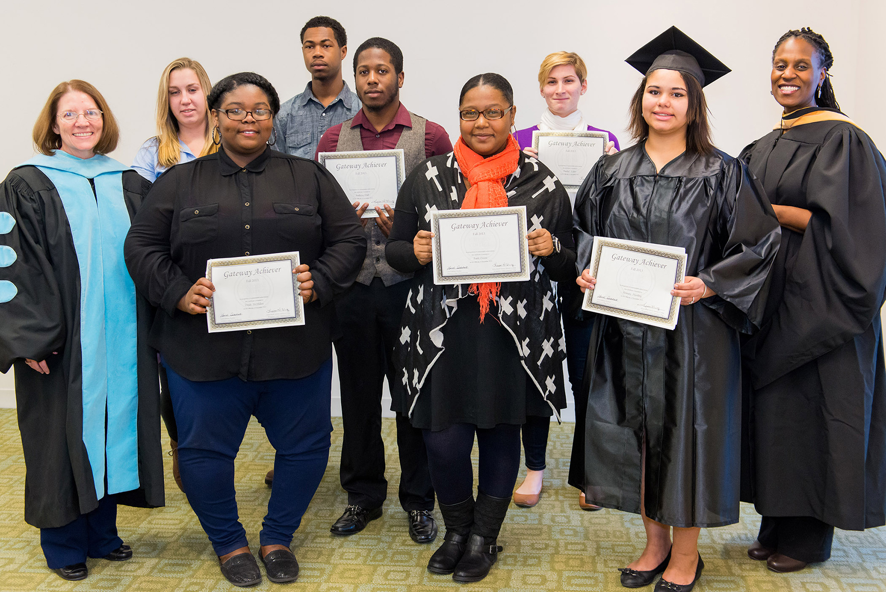 Recipients of the Gateway to College Achiever Awards included (front row, from left) Dejah McMillan, Faith Owens and Brittany Harding and (back row, from left) Rosemary Lux, Khary Harris, Anthony Hall, and Rachel Voltz. Standing with the group are MCCC Vice President for Student Affairs and Enrollment Management Kathrine Swanson (left) and Gateway Program Director Keima Sheriff (right). Missing from the photo are Marcus Gordon, Amber Keys and Yasmin Rich.