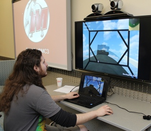 Student Zac Chelbi demonstrates a level on The Big Robot Game