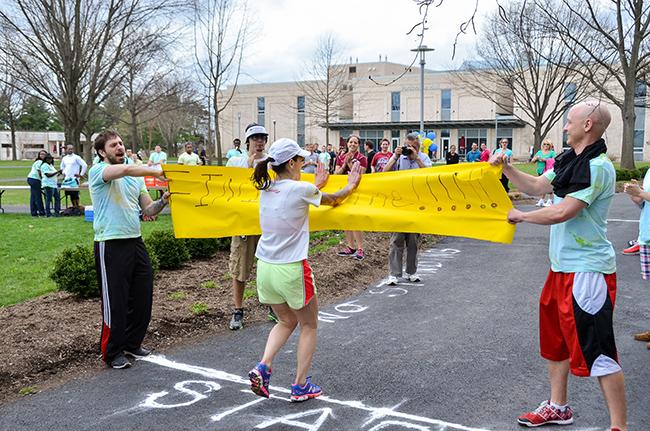 Assistant Professor of Economics Jill Beccaris-Pescatore won the 5K race