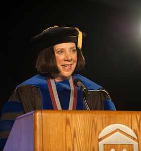Dr. Celeste Schwartz addresses 2014 graduates. Photo by John Welsh