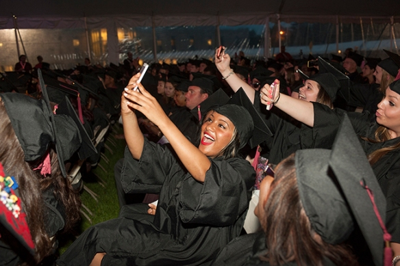 Graduates take selfies at the College's 2014 Commencement ceremony. Photos by John Welsh