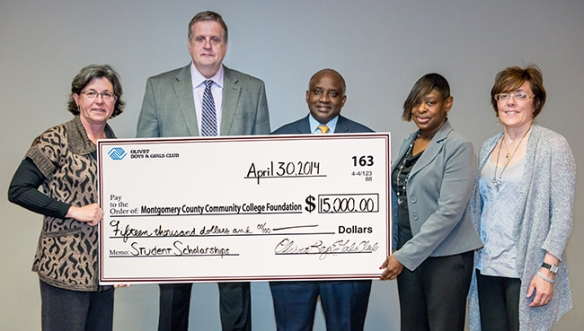Olivet Boys and Girls Club of Reading and Berks County presented a $15,000 check to the Montgomery County Community College Foundation on April 30 for student scholarships. The Foundation is adding an additional $5,000 to the scholarship program. From left, College President Dr. Karen A. Stout, Olivet Interim CEO Dr. James Smith, Vice President of West Campus Steady Moono, Ricketts Center Club Director Janice Burgess and Olivet Development Director Camille Stock. Photo by Sandi Yanisko