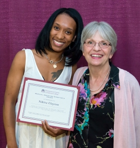 Kathy Schreiner, Director of Medical Professions, presents Nikita Clayton with the 2014 Medical Assisting Director's Award. Photo by Sandi Yanisko